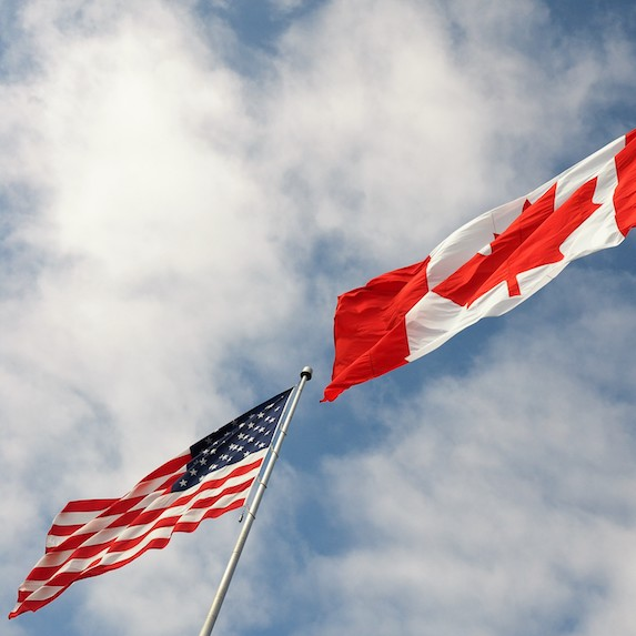 Canadian flag and American flag