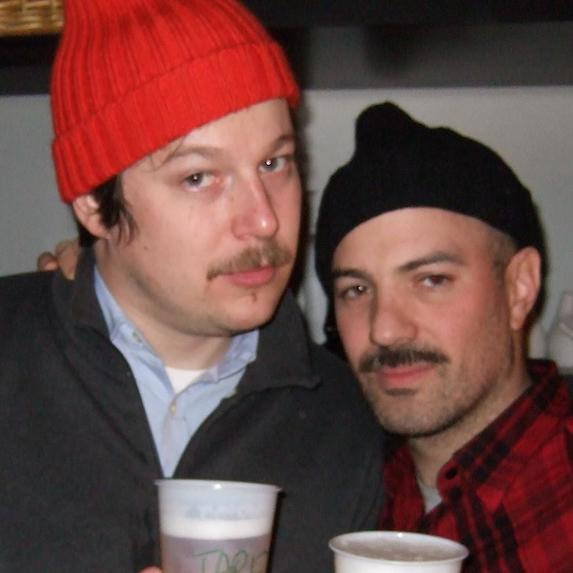 Two guys wearing toques
