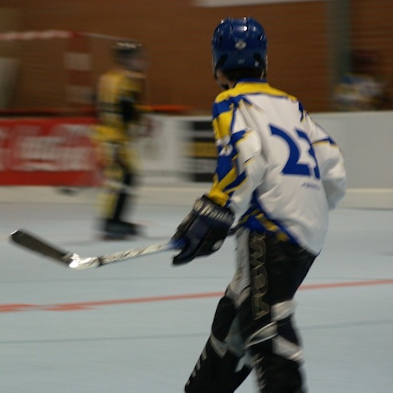 Young people playing hockey