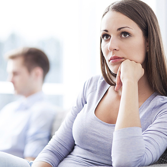 Woman in thought with man in background