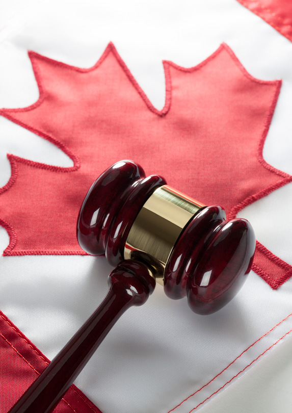 A gavel sits atop a Canadian flag