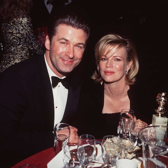 Alec Baldwin and Kim Basinger sit at a table during the Golden Globe Awards ceremony