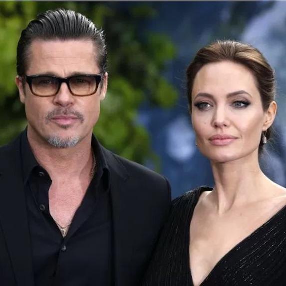 Brad Pitt poses with former wife Angelina Jolie