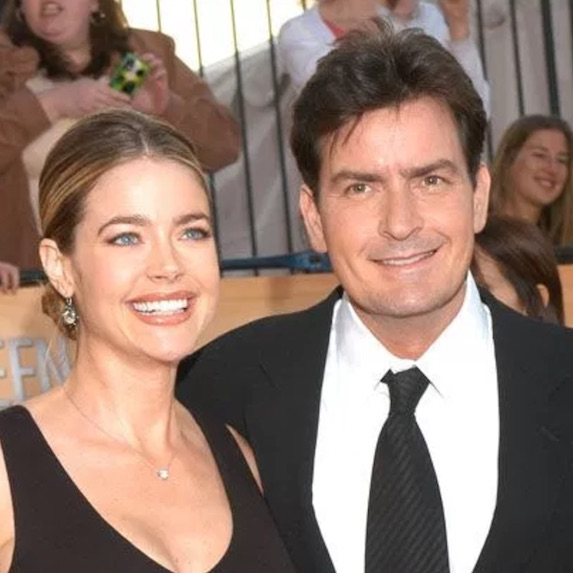 Charlie Sheen smiles with then-wife Denise Richards
