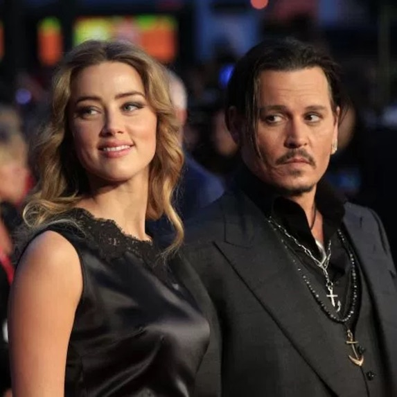 Johnny Depp and former wife Amber Heard pose on the red carpet