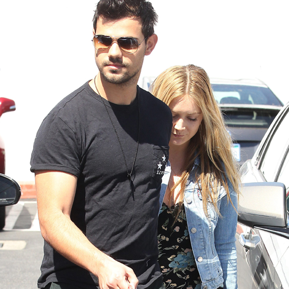 Billie Lourd and Taylor Lautner mid-stride