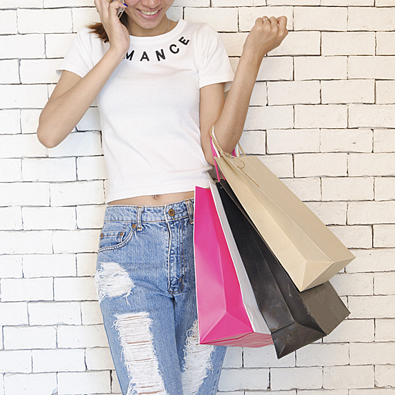 Woman with lots of shopping bags on her arm