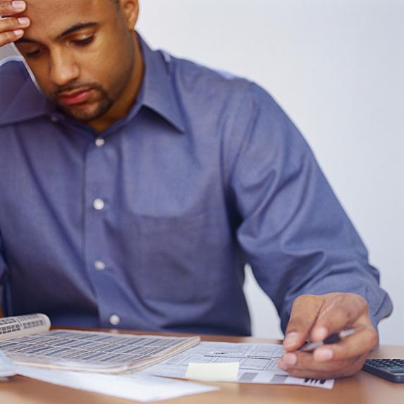Frustrated man looking at bills