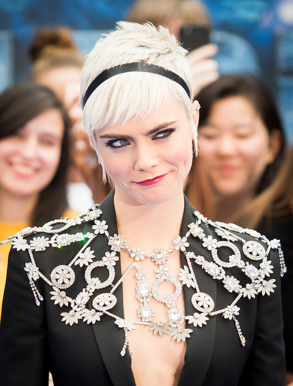 Actress Cara Delevingne on the red carpet for 'Valerian' wearing a black blazer and silver statement necklace