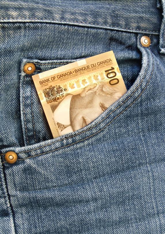 A $100 bill in a denim pocket