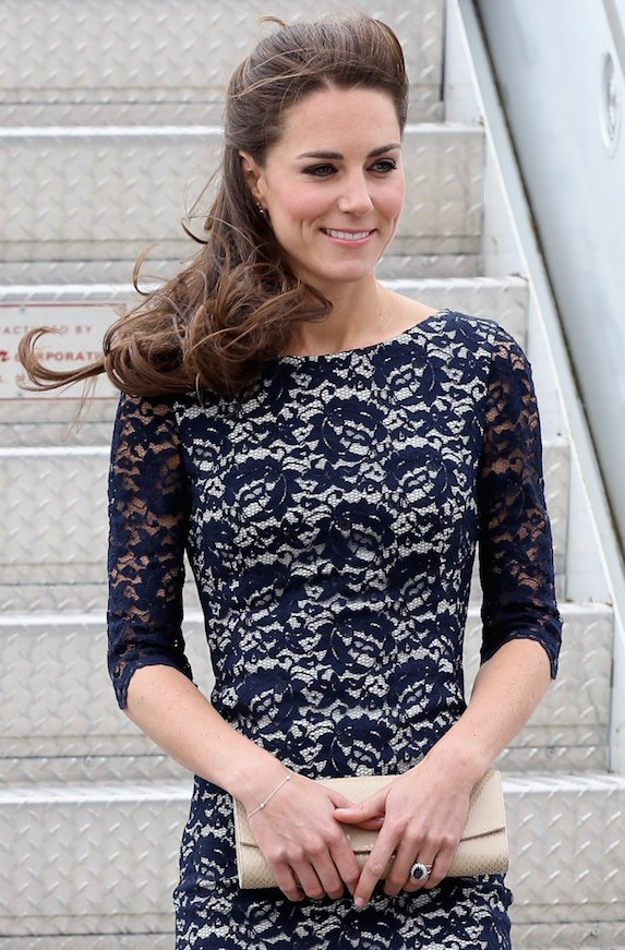 Kate Middleton disembarks in Canada on the 2011 Royal Tour in Canada wearing a lace dress by Canadian-born designer Erdem