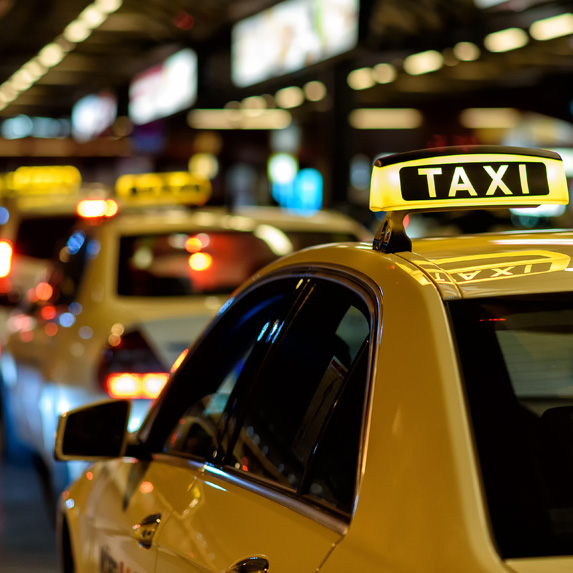 A road lined with taxi cabs