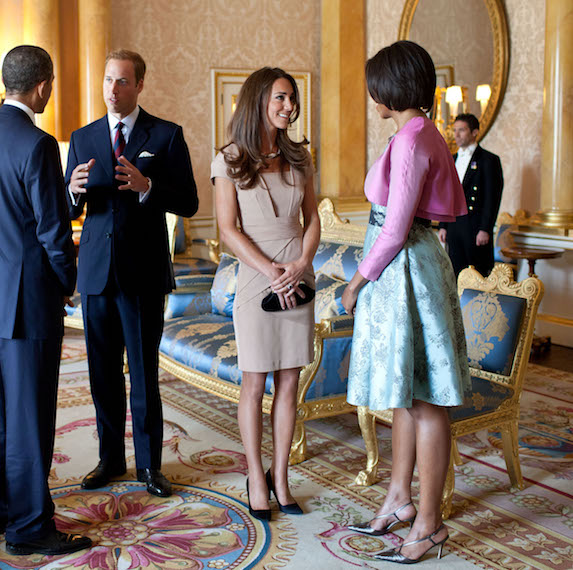 Kate Middleton stands speaking to former first-lady Michelle Obama at the White House, as Prince William and former president Barack Obama stand in conversation closeby