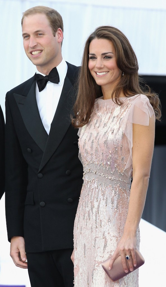 Kate Middleton stands next to husband Prince William while wearing a blush-coloured formal gown