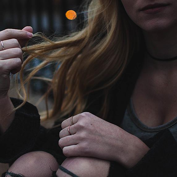 Woman running fingers through hair