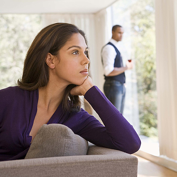 Pensive woman with man in distance