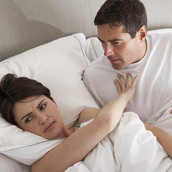 Disinterested woman and man in bed