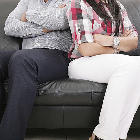 Man and woman on couch facing opposite ways