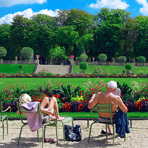 A woman and man sunning in a garden