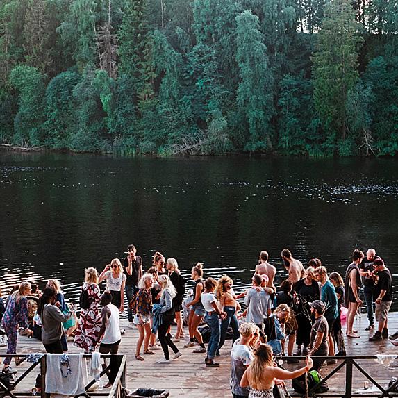 Crowd of people lakeside