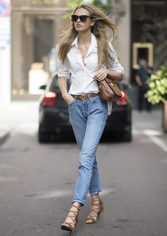 Model Romee Strijd photographed wearing jeans, a white shirt, sandals and a Gucci belt