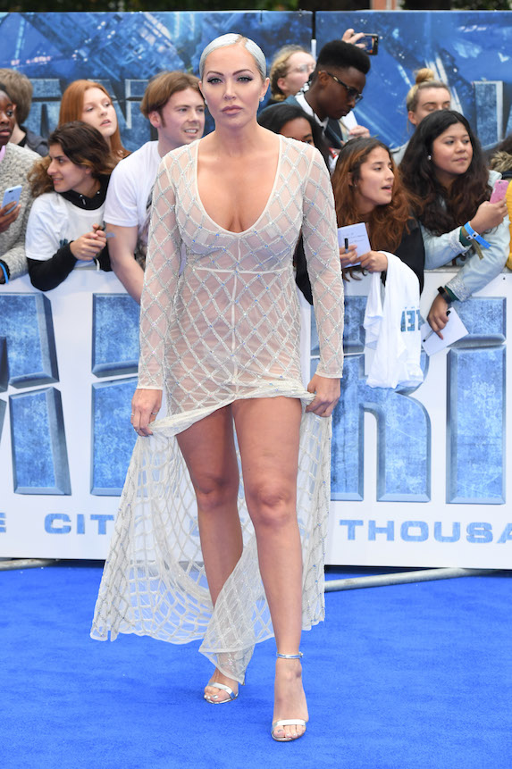 Actress Aisleyne Horgan-Wallace in a beaded, low-cut sheer gown with a high slit