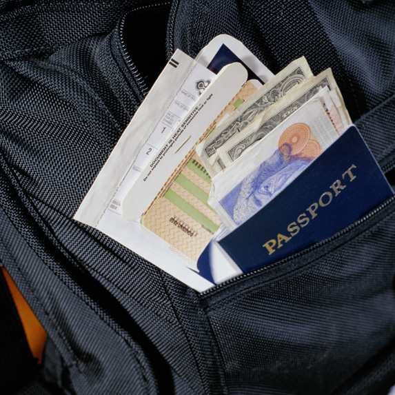A passport, cash and documents stashed hastily in a backpack