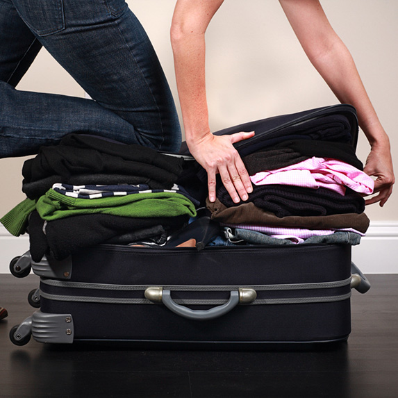 Stuffing a suitcase