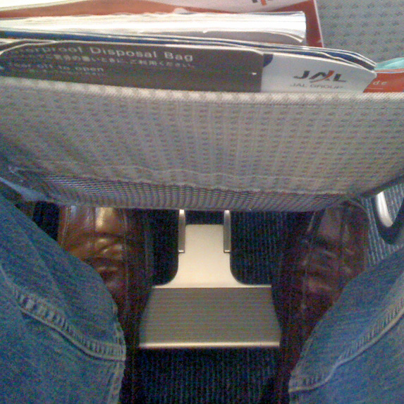 Foot rests on plane