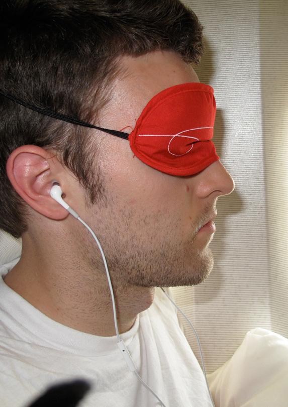 Man wearing a sleep mask