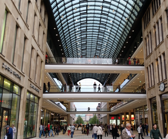 A glass dome ceiling gives way to levels of shops within the Mall of Berlin