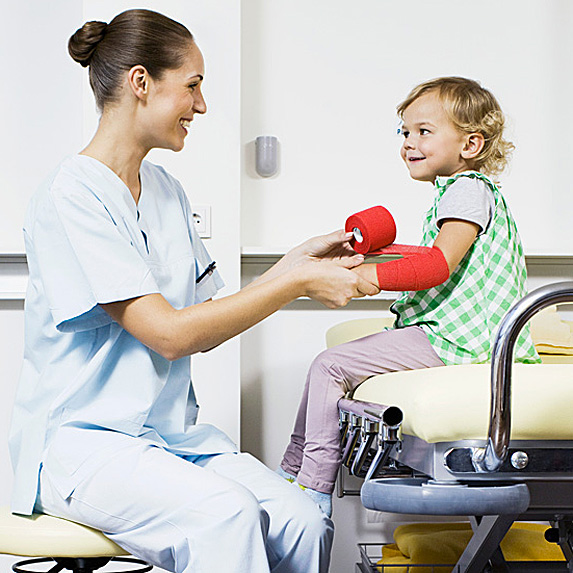 Nurse tending to young patient