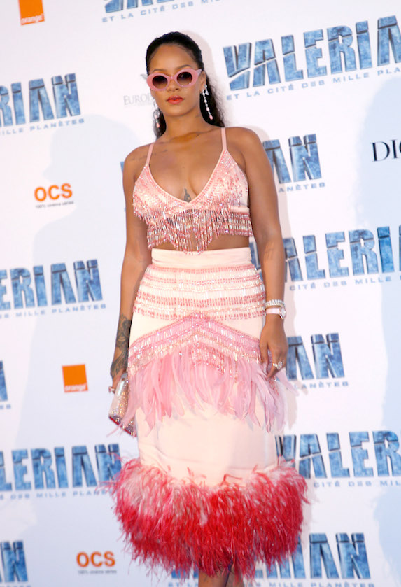 Rihanna attends a movie premiere in a pink feather and fringe-detail gown