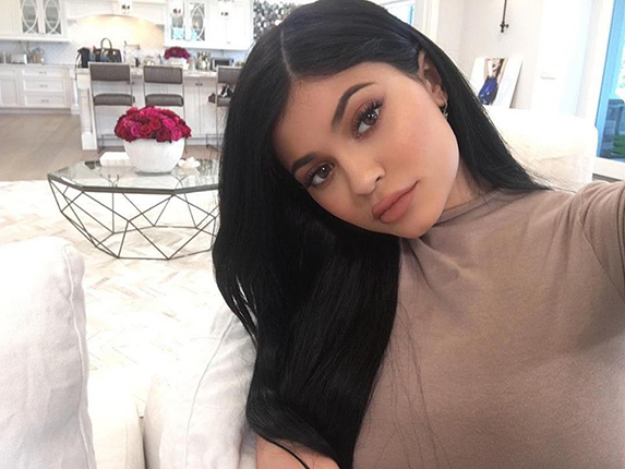 Kylie Jenner taking a selfie with long black hair