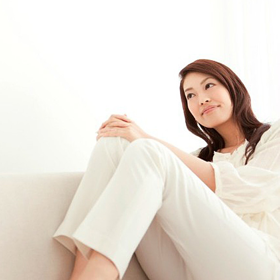 Smiling woman sitting on couch