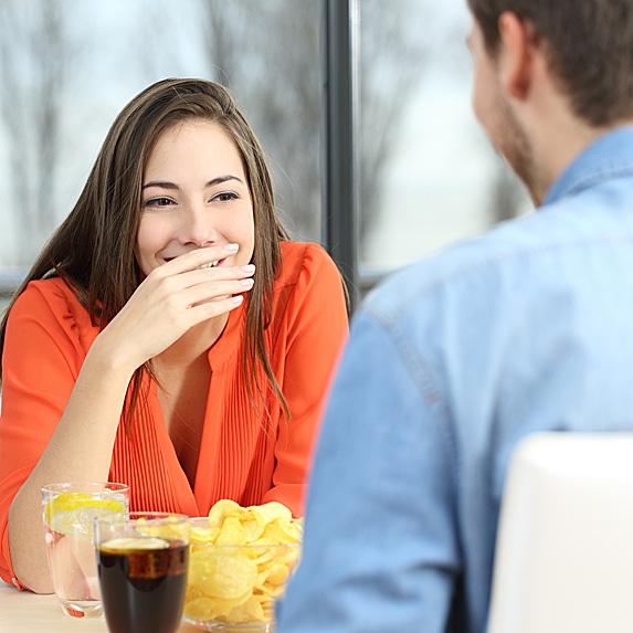 Woman laughing at man