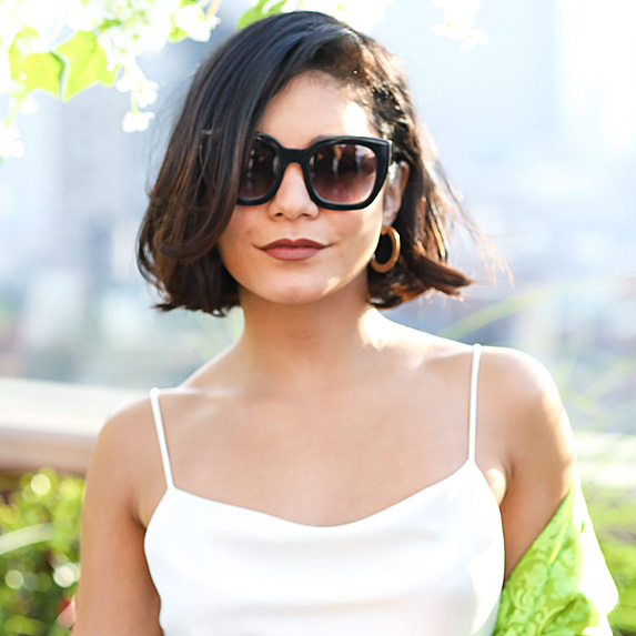 Vanessa Hudgens wearing sunglasses and her hair in a bob.