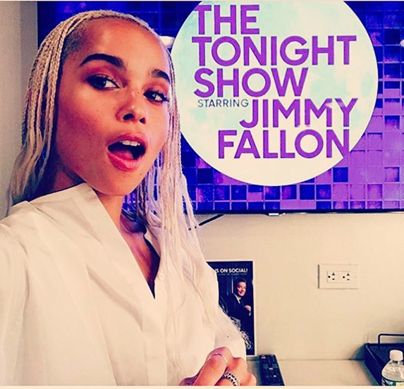 Zoe Kravitz with long blonde braids in front of a sign that reads The Tonight Show Starring Jimmy Fallon