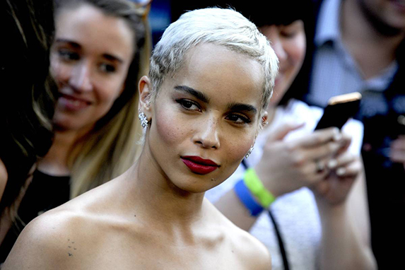 Zoe Kravitz with a short blonde pixie cut wearing red lipstick