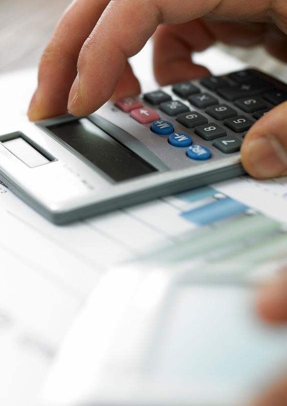 Man calculating debts