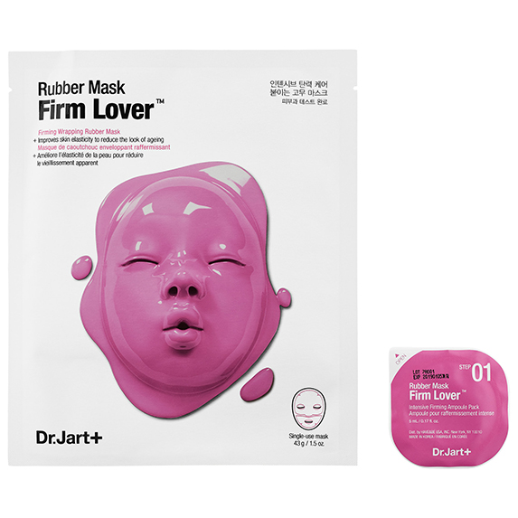 The white packaging of a skincare product with a dark pink rubber mask on it.