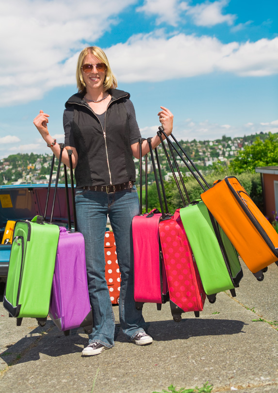 Woman with many suitcases