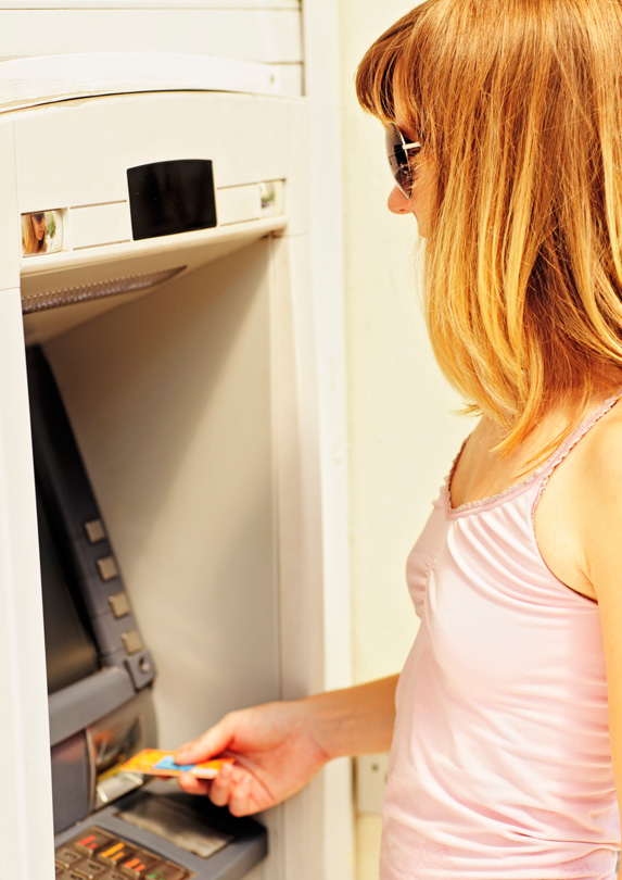 Woman using and ATM