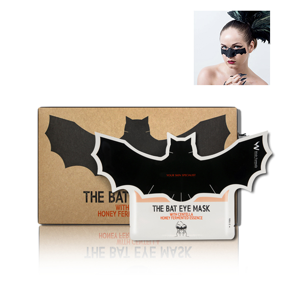 A brown box with a bat-shaped black eye mask on it and a photo of a woman wearing the mask in the upper right corner.