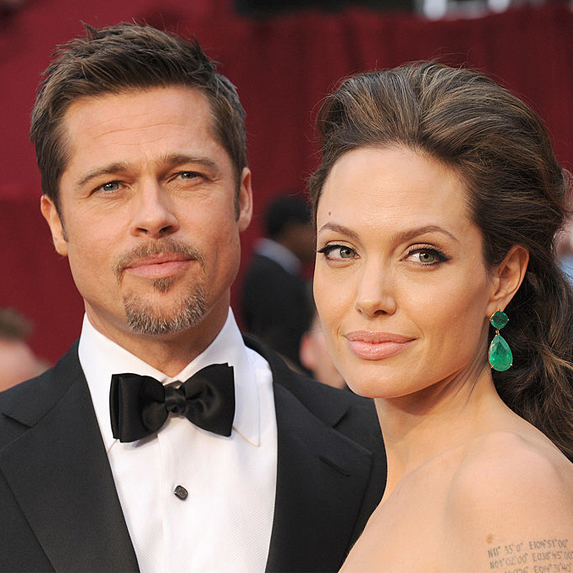 In happier times, Angelina Jolie and Brad Pitt are photographed together on the red carpet