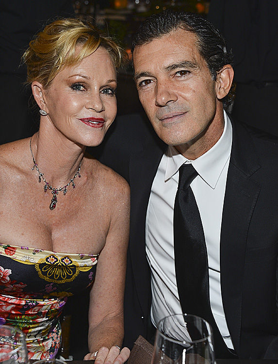 Photographed together in happier times, Melanie Griffith and Antonio Banderas are all smiles sitting together at an event