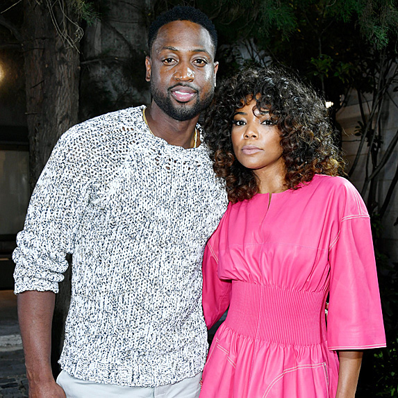 Pro athlete Dwayne Wade and wife and actress Gabrielle Union pose together for a photograph