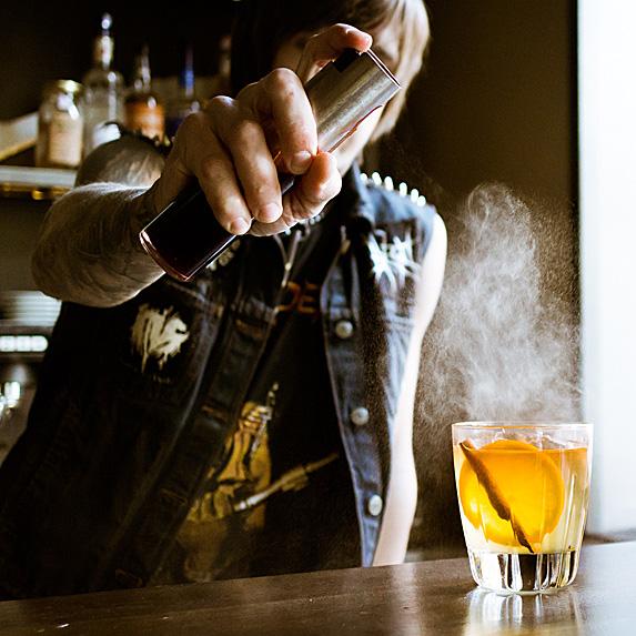 Bartender making elaborate drink