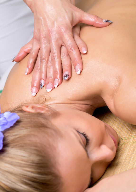 Massage therapy performed on woman