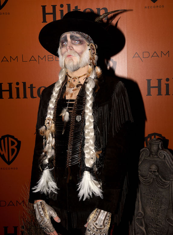 Singer Adam Lambert hosts a Halloween party dressed as a ghost from western times